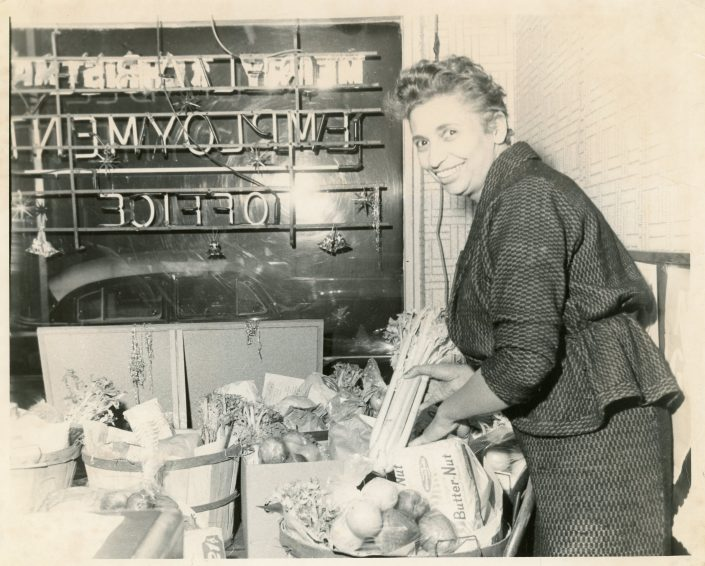 Preparing food baskets for the hungry at her Employment Office in Milwaukee